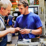 Two men in a manufacturing operations setting