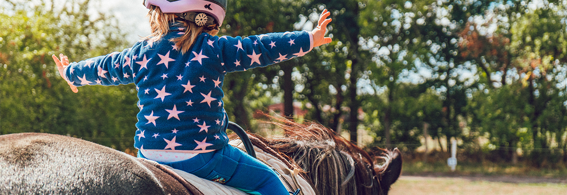 girl riding a horse courage